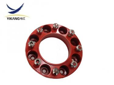 Wheel spacer for skid steer loader