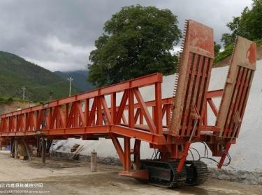 Crawler steel track undercarriage for tunnel trestle