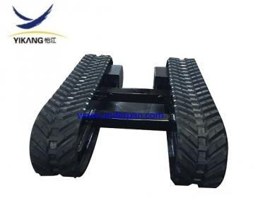 Rubber track undercarriage for drilling rig